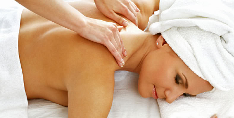 Photo of woman receiving massage therapy at Serenity Massage Therapy